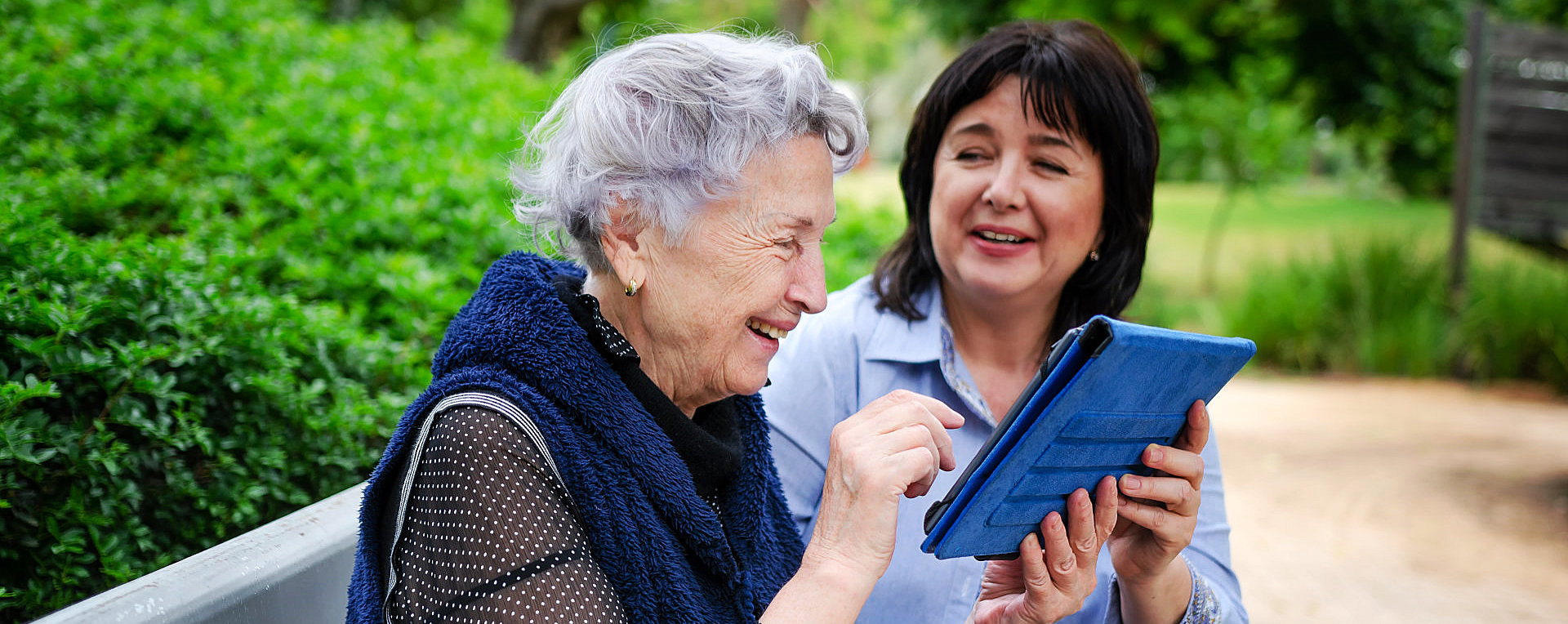 caregiver giving a tablet to patient